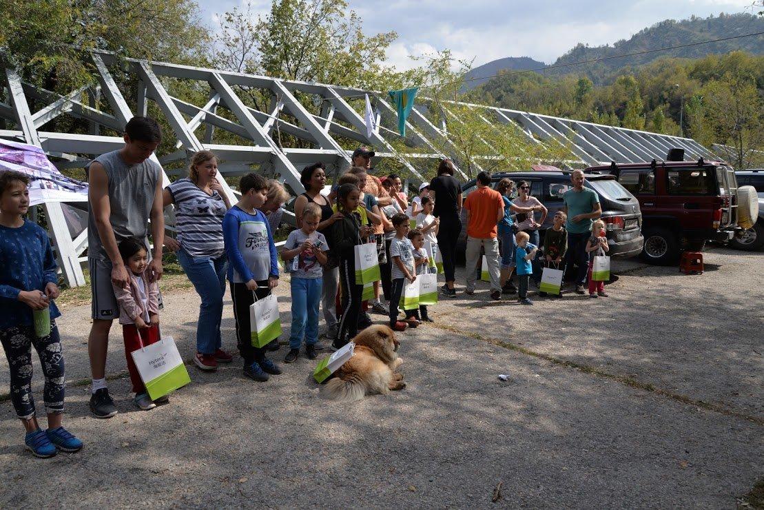 На верёвках через реку и гитара у костра: осенний слёт туристов прошел в Алматы (фото), фото-11