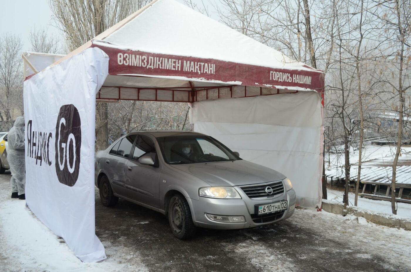 Как дезинфицируют машины, выполняющие заказы сервиса Яндекс.Такси в Алматы, фото-1